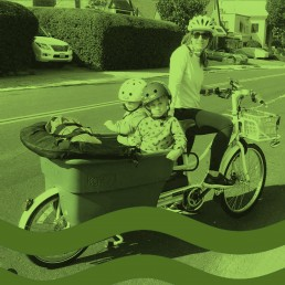 woman and two kids on bike